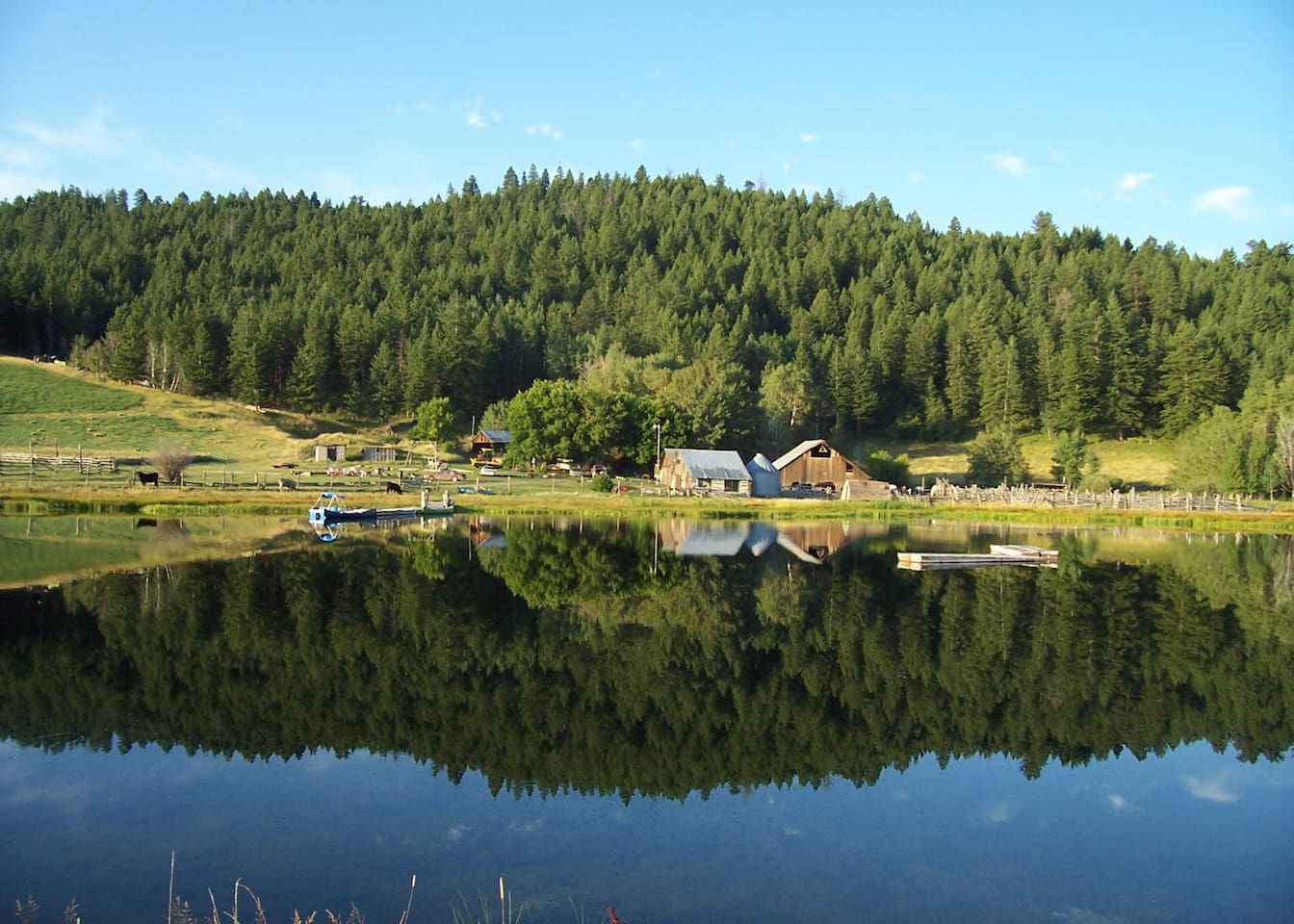 Granite Lake if the perfect mirror for the ranch headquarters and the beautiful forest.