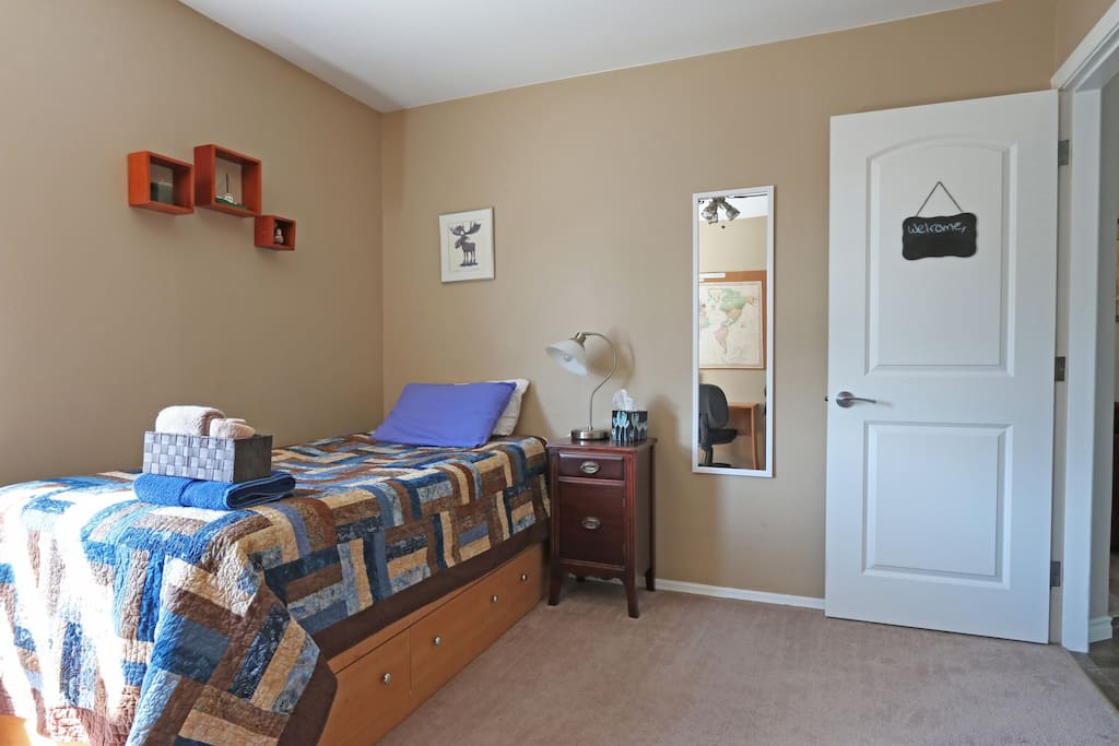 Bedroom also includes a full-length mirror.