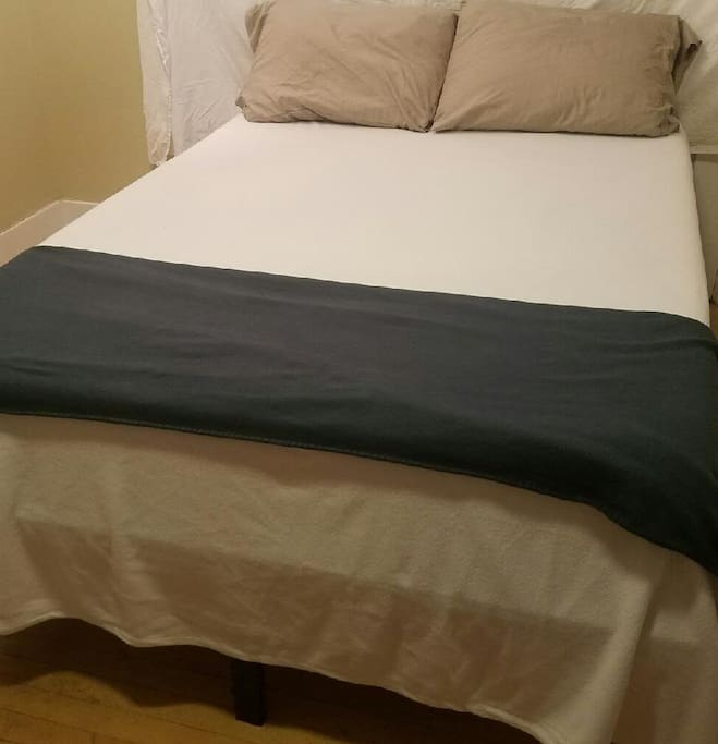 """I offer a Brand new """"Tuft and Needle""""double bed.  It is soft, and plush. A small desk, hardwood floors, and oh yeah, the view is amazing."""