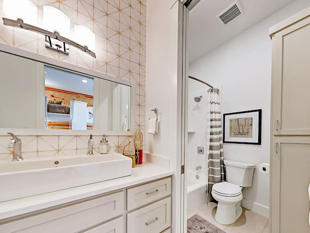 The 3rd bathroom is en-suite, featuring a dual sink and a separate room for the tub/shower combination.