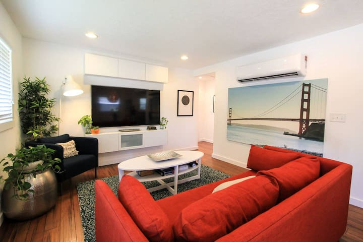 Spacious living room with big screen TV
