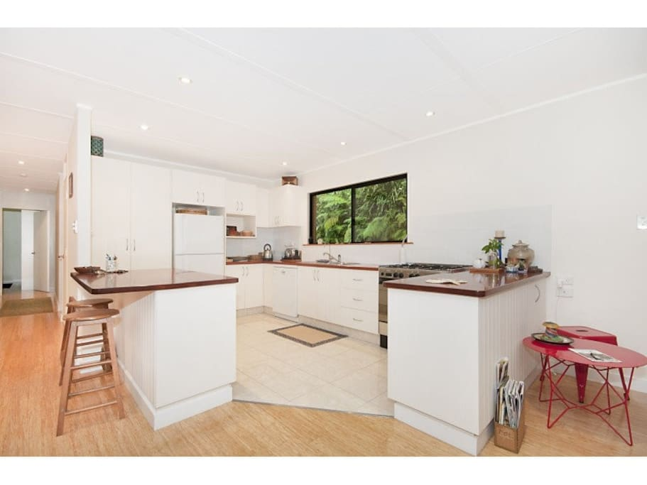 well equipped kitchen with gas stove and dishwasher