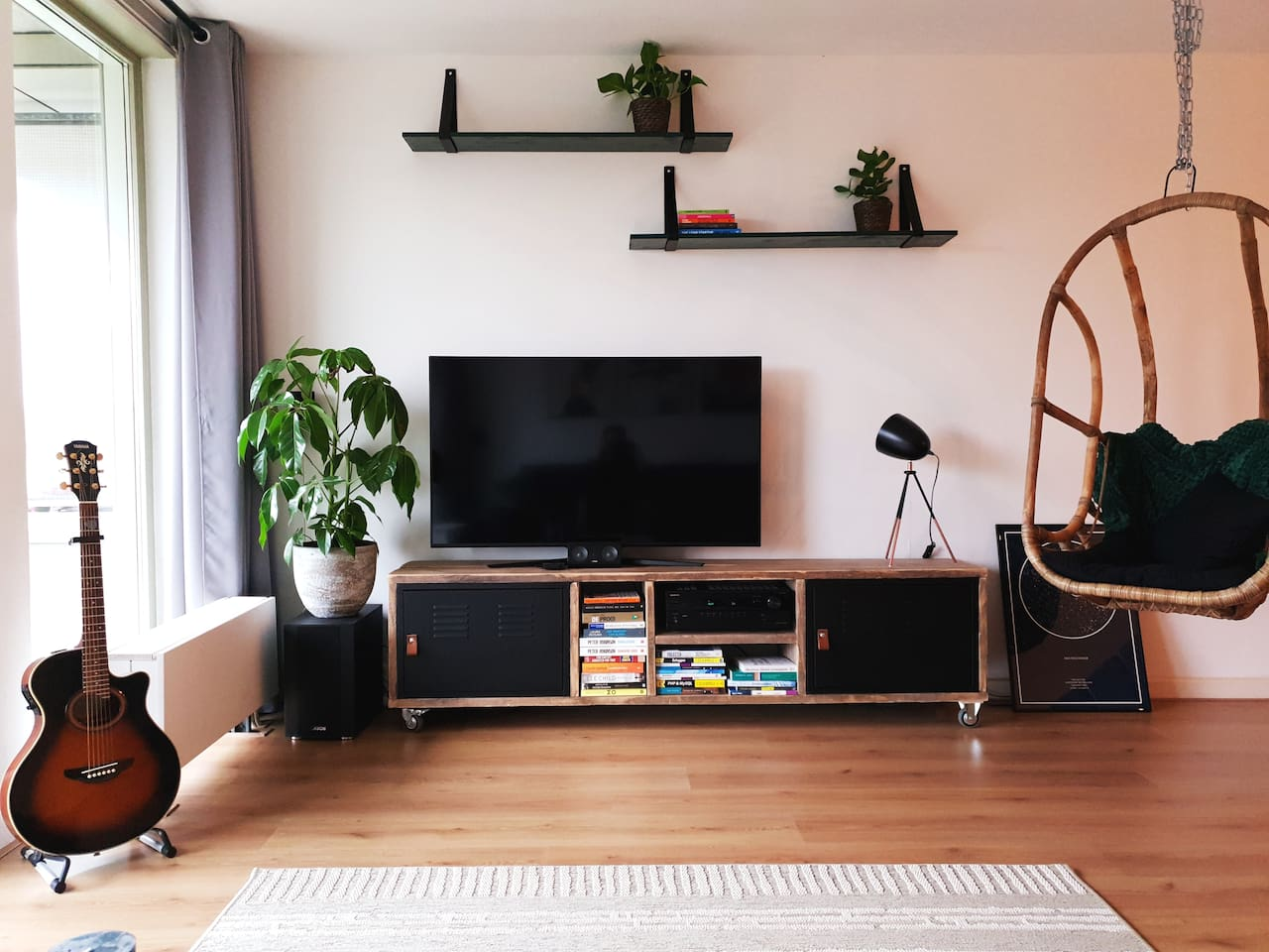 55 inch TV, 5.1 surround and hanging chair to relax