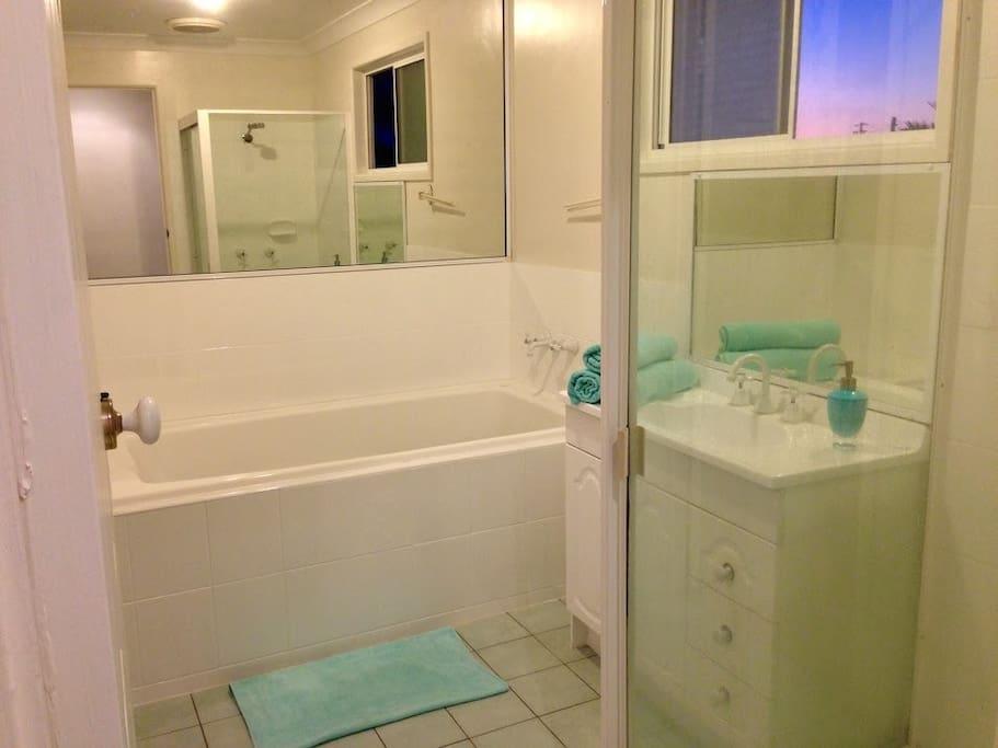 Private Bathroom with a walk-through
