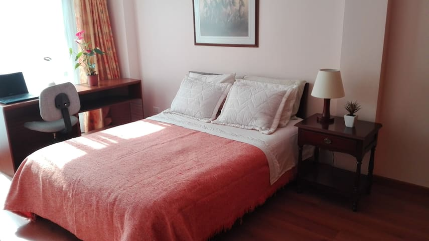 Private bedroom with double bed, nighttable w/lamp, desk with chair & lamp, terrace (with table and 2 chairs) and big closets.