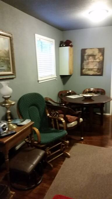 Dining / game table has 4 chairs.