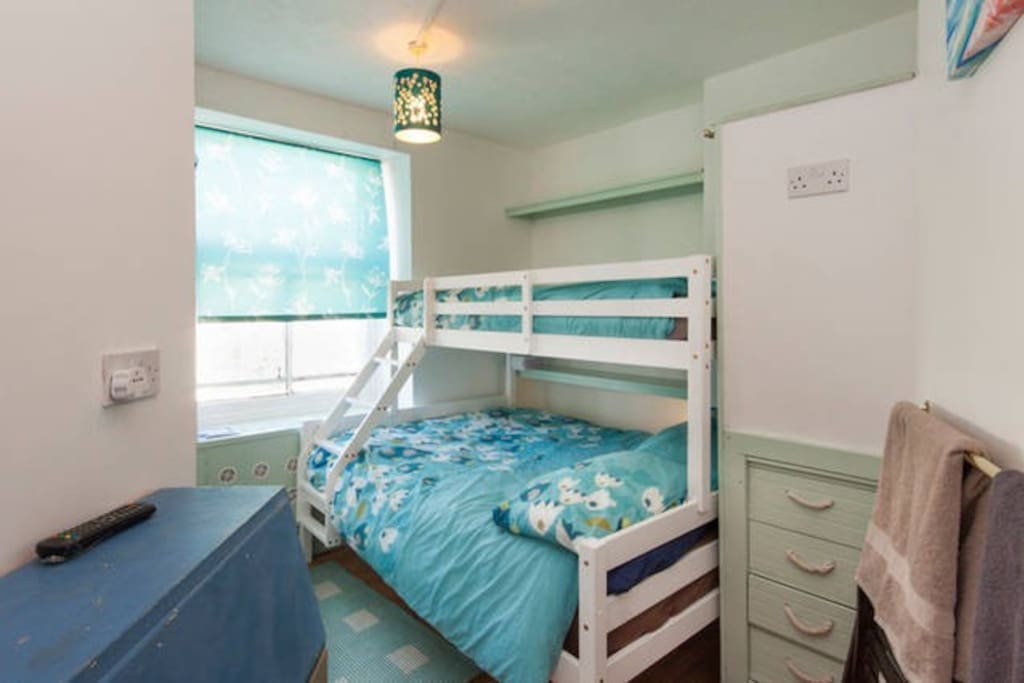 A compact room but with a full size double and single bunk bed