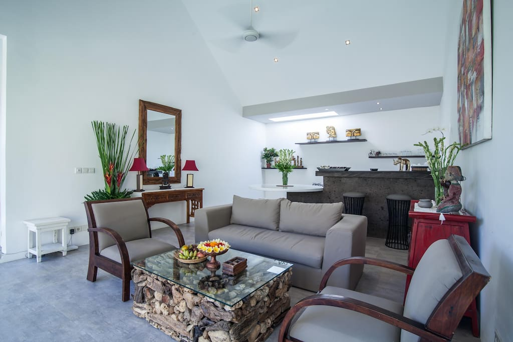 Spacious living room with it's fully equiped kitchen