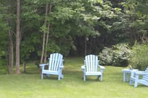 6 Muskoka chairs in the private sitting area at the water