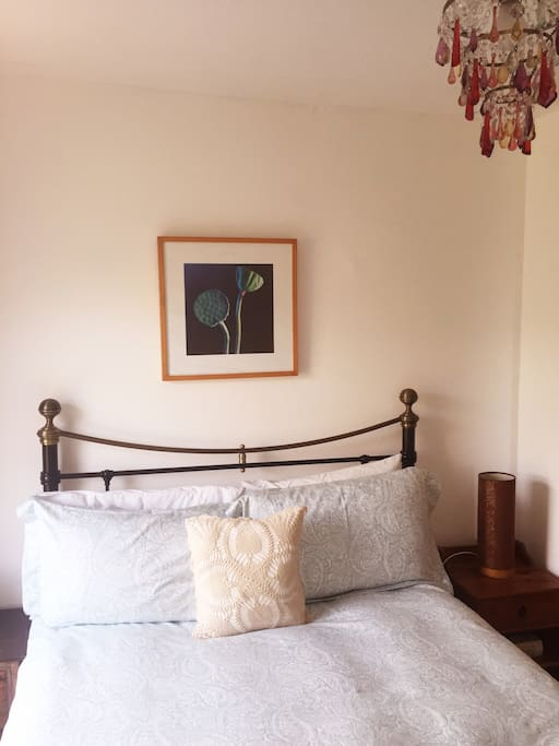 Double bed with wool topper and duck down king size duvet.