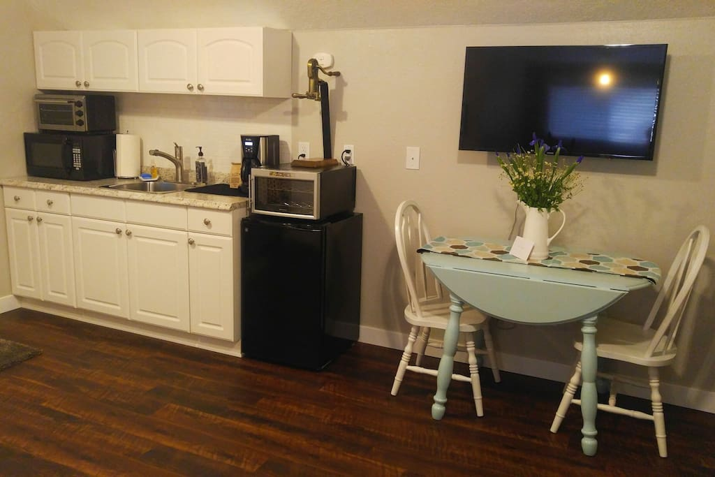 Kitchenette includes microwave, toaster oven, sink, mini fridge, wine fridge, and coffee maker.