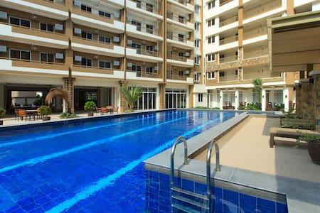 Resort Inspired Condo near GMA 7 - San Juan