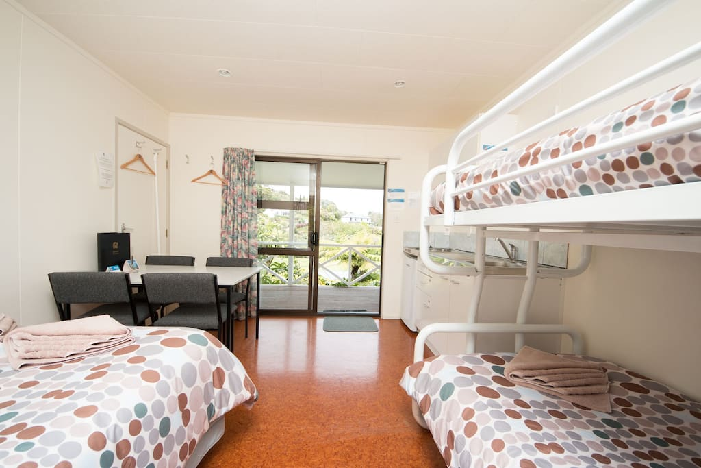Double bed and single bunk beds.