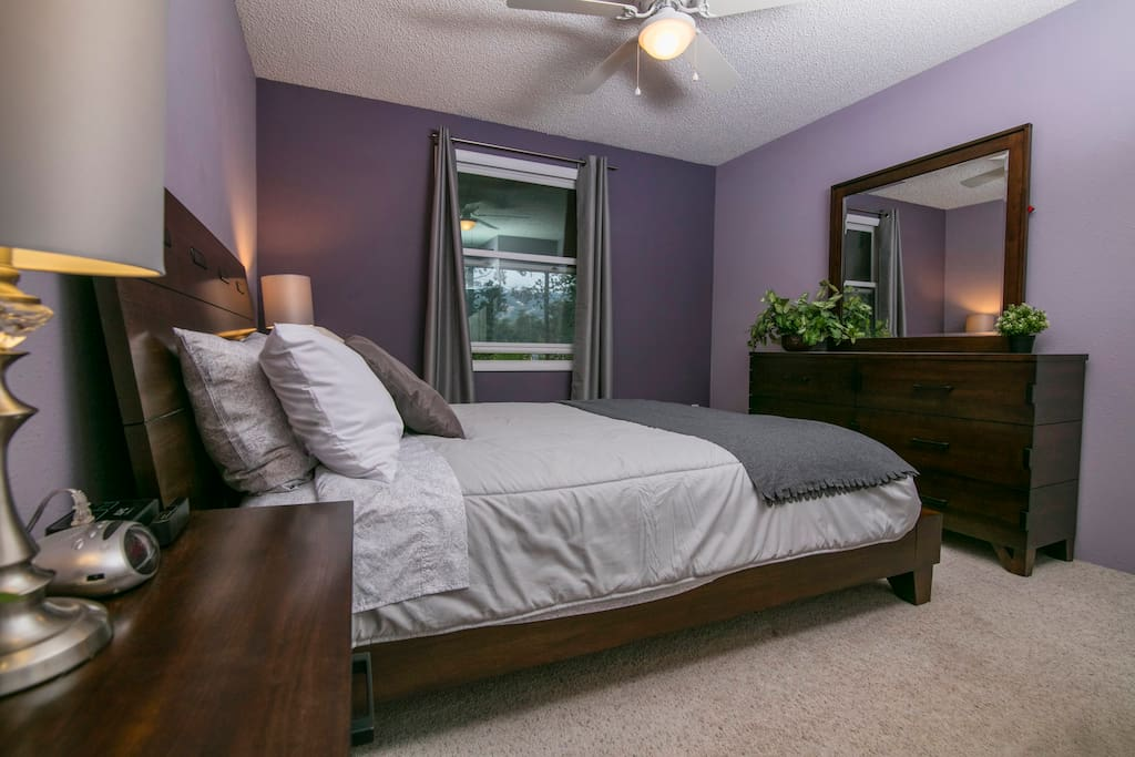 Master Bedroom has a queen bed and ceiling fan.