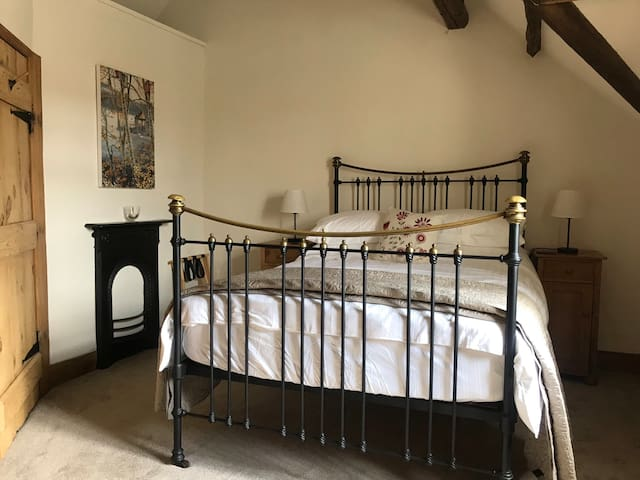 Spacious double bedroom with Victorian brass bed & beamed ceiling