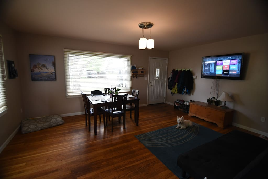 Upstairs, main living room and entry way. There's a futon if you need extra sleeping space.