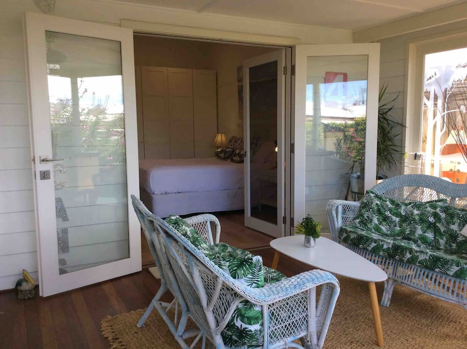 """Verandah""""room"""" with views to the harbour opens to the Queen bedroom."""