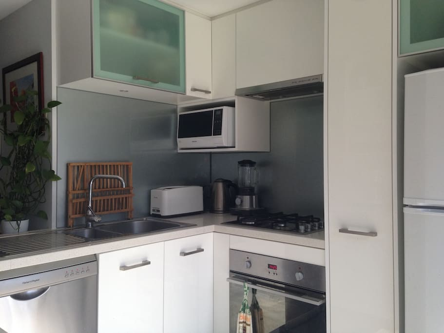 Our kitchen includes microwave, oven and dishwasher.