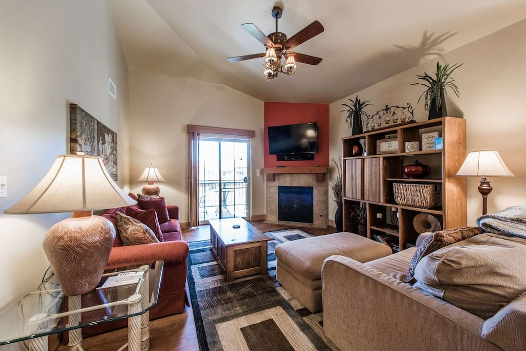 Big Screen TV,  DVD, Cathedral Ceilings, Fireplace and private balcony