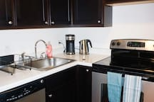 Fully equipped kitchen with dish washer, stove, oven, coffee & tea maker.