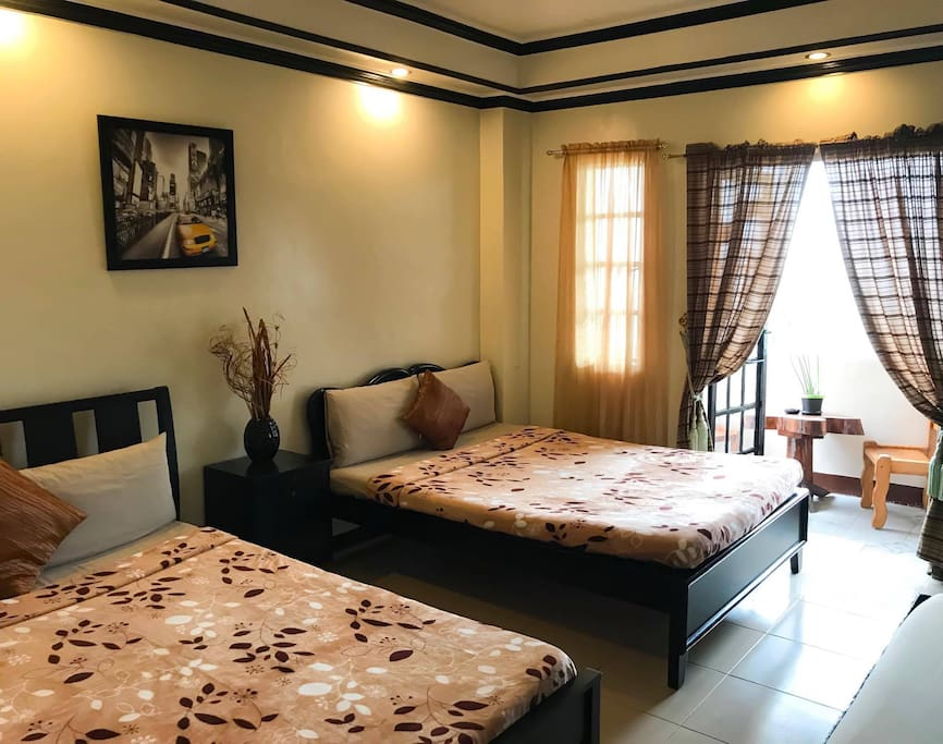 Room 1: 2 Queen size bed, 1 single bed, 42 inch lcd cable tv, bathroom with hot and cold shower and private balcony.