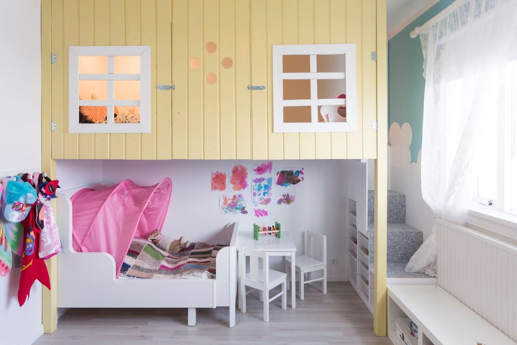 this child room was custom made and has a playhouse for kids.