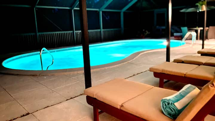 Renovated home w. heated pool steps to the beach.