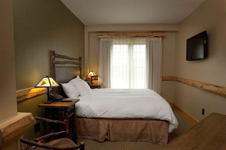 Drift off to sleep in the plush double bed. Bedding configurations may vary
