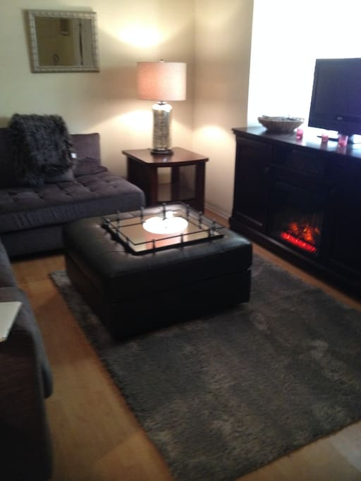 livingroom-complete with a gas fireplace and netflix:) the couch is super comfy.
