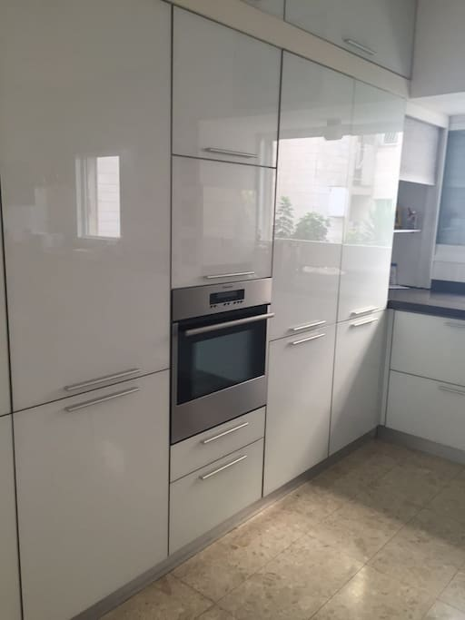 kitchen with oven, laundry machine/dryer