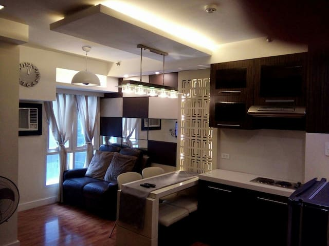 Cozy 1BR bilevel Condo in Ortigas Center - Pasig - Condominium