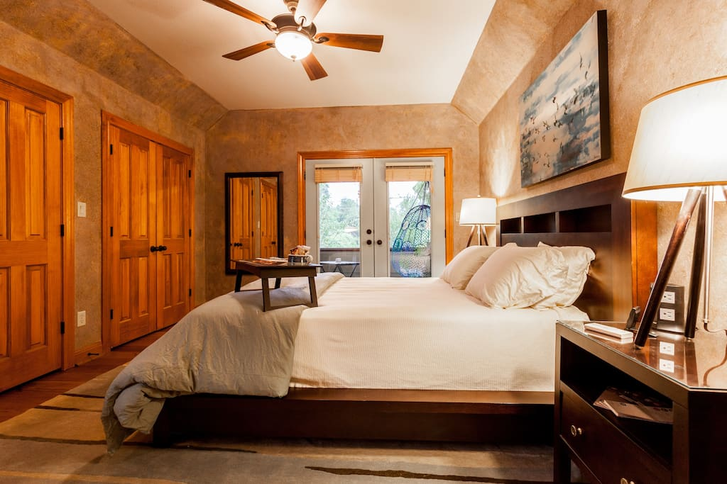 You'll appreciate the wool rug under your feet on those cold winter mornings. The ceiling fan and lights are all remote controlled. Oh, you also have 8 outlets and 4 USB charging stations on your bedside table...no crawling around to plug in your phone!