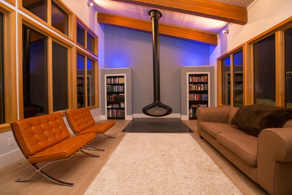 Incredible living room with hanging fireplace and beautiful accent lighting.