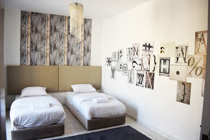 Bedroom with 2 single beds that can be joined into 1 king-size bed