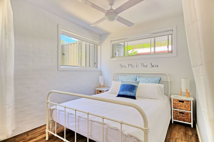Beachside tranquility for two... A queen size bed with a King size Doona [duvet]