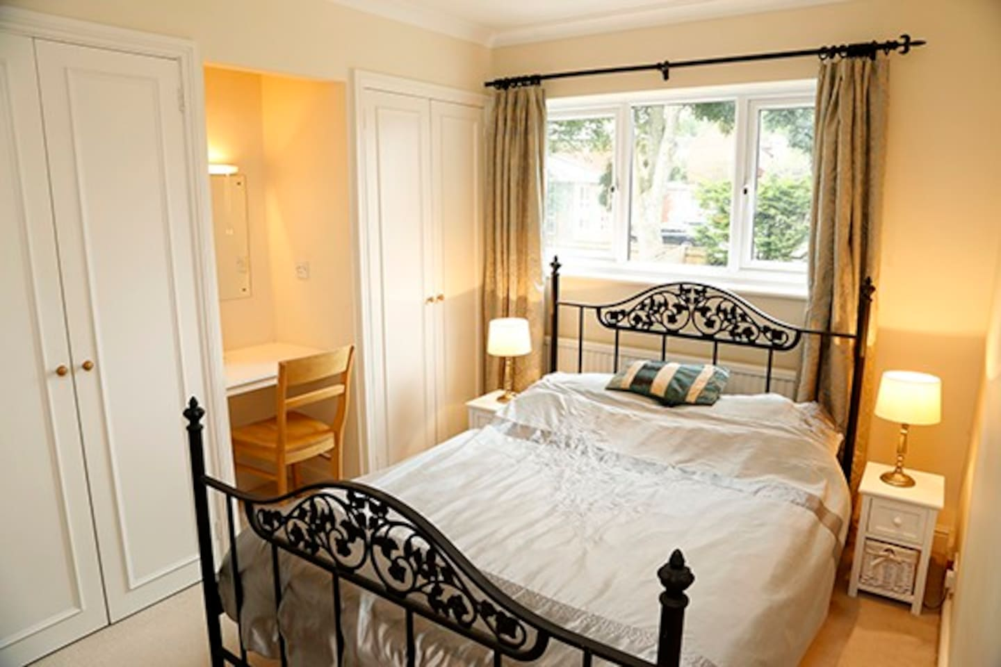 Bright, light, airy double room with large flat screen TV.  Small desk/vanity area with chair, wardrobe & drawers. Lovely and quiet. Tea & coffee making facilities in the room. The room is next to the 2nd double room - ideal for friends & families.
