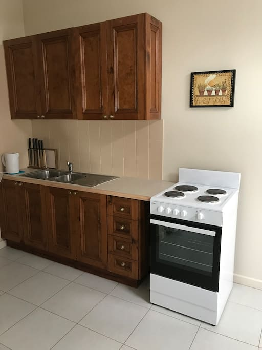 Well equipped kitchen with brand new stove, oven and grill.