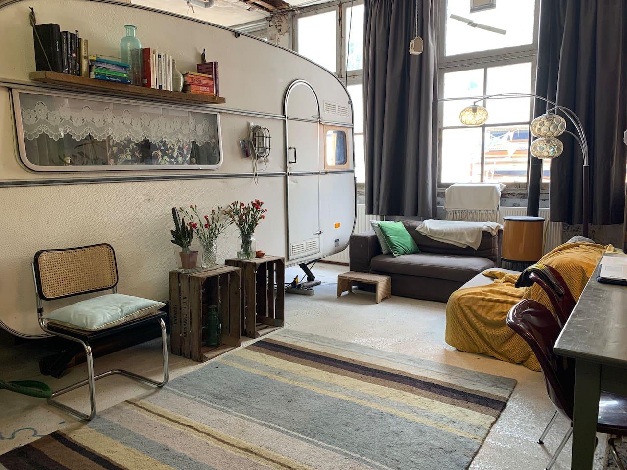 Living room with open kitchen and master bedroom/caravan