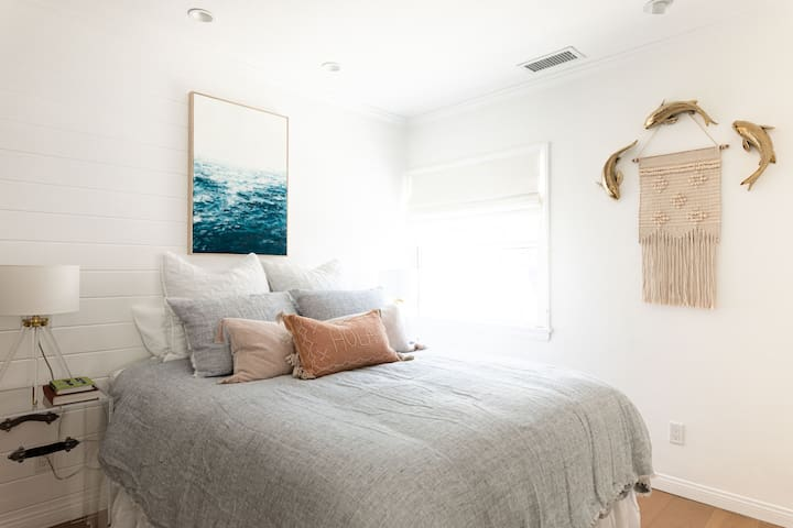Queen bed with Pom Pom linens