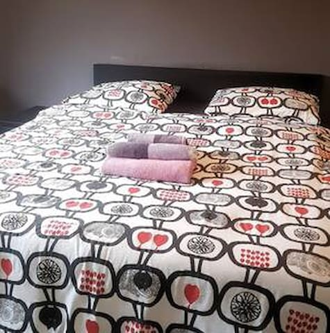 Comfortable queen size bed. This is also the master bedroom