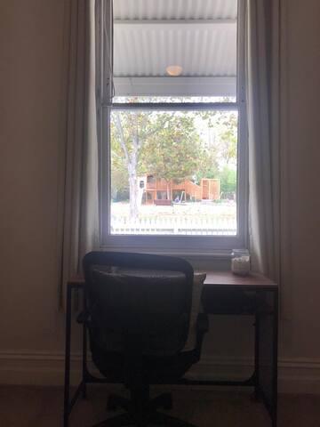 Desk overlooking park