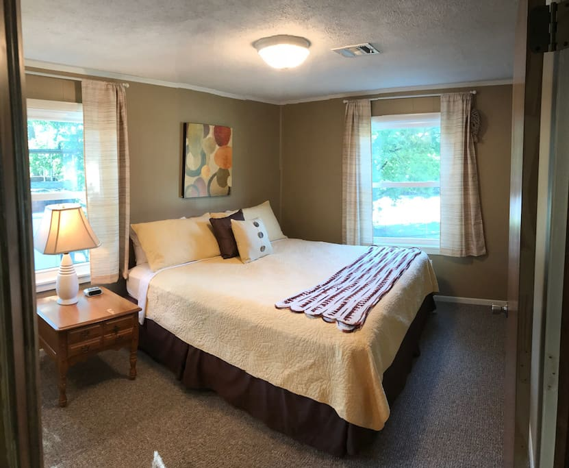 Master bedroom has a king size bed and private bathroom attached.