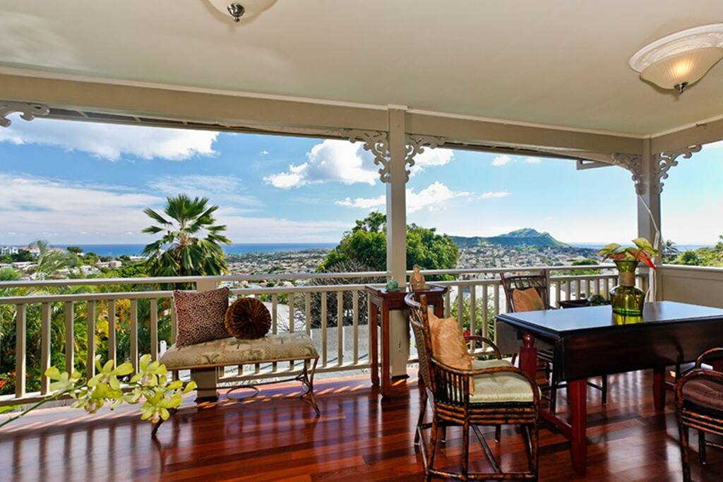 Stunning ocean views by day and city lights at night! Upstairs dining area. (Murphy bed is hidden on this lanai with comfortable Queen mattress)