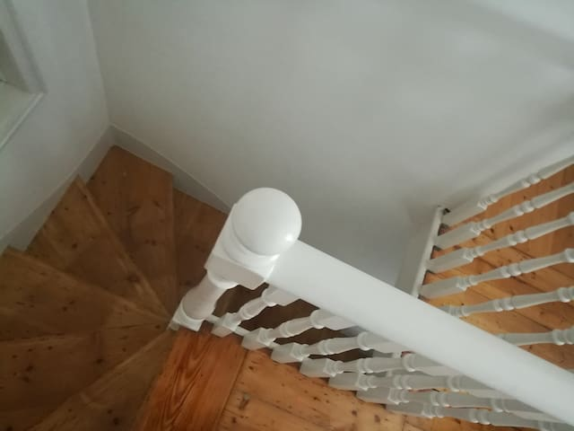 Staircase for those staying upstairs or using upstairs kitchen, work and common areas, or roof deck.