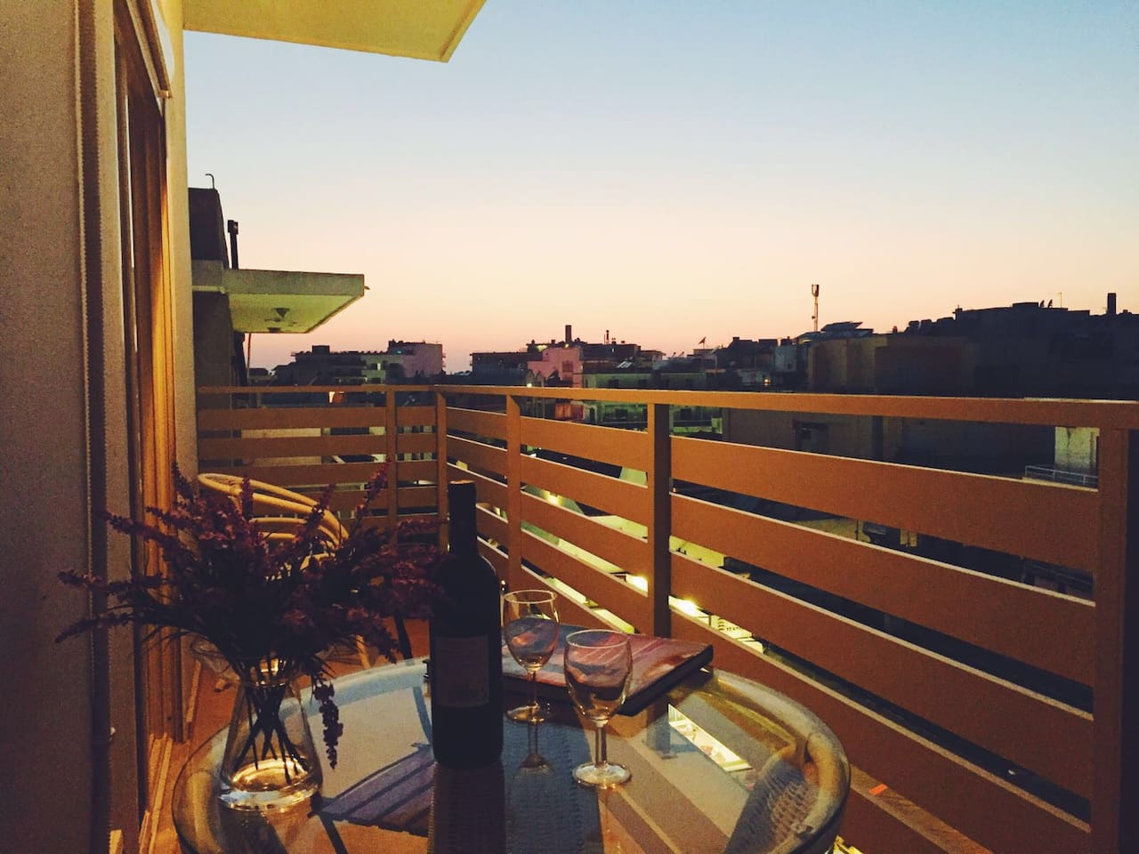 Wine and brilliant sunset, while chilling at the balcony with a magnificent view