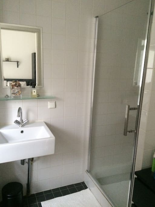 Clean and recently refurbished bathroom with large shower.