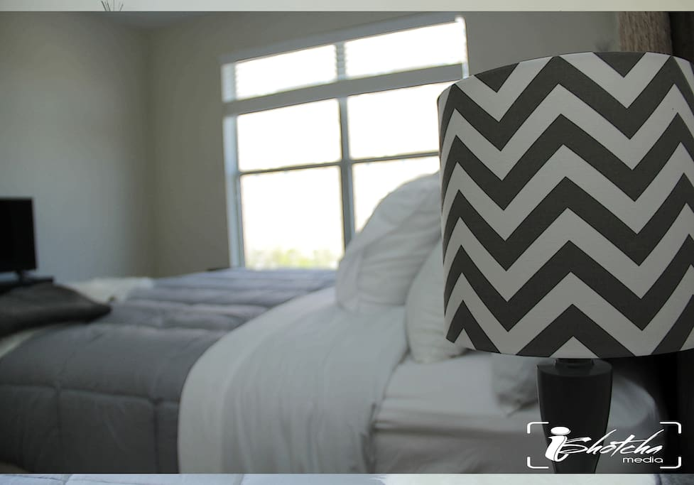 King size bed with smart tv in the bedroom.