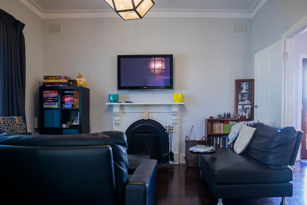 Living room with lots of board games and dress ups for kids.   Entertainment system includes Apple TV, Netflix, Nintendo Wii