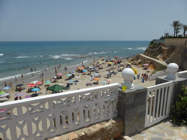 Gate with private staircase down to Cala capitan Beach  in cabo roig