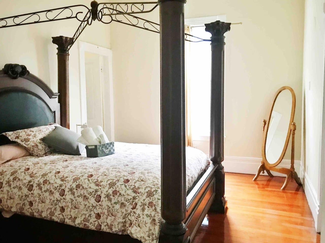 """Naomi's Grand Foyer has an elegant large queen bed and direct access to the """"Powder Room"""" (restroom)."""